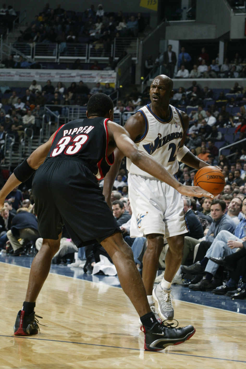 WASHINGTON - DECEMBER 10:  Guard Michael Jordan #23 of the Washington Wizards looks to play the ball as guard Scottie Pippen #33 of the Portland Trail Blazers defends during the game at MCI Center on December 10, 2002 in Washington, DC.  The Trail Blazers won 98-79.  NOTE TO USER: User expressly acknowledges and agrees that, by downloading and/or using this Photograph, User is consenting to the terms and conditions of the Getty Images License Agreement.  Mandatory copyright notice: Copyright 2002 NBAE  (Photo by: Noren Trotman/NBAE/Getty Images)